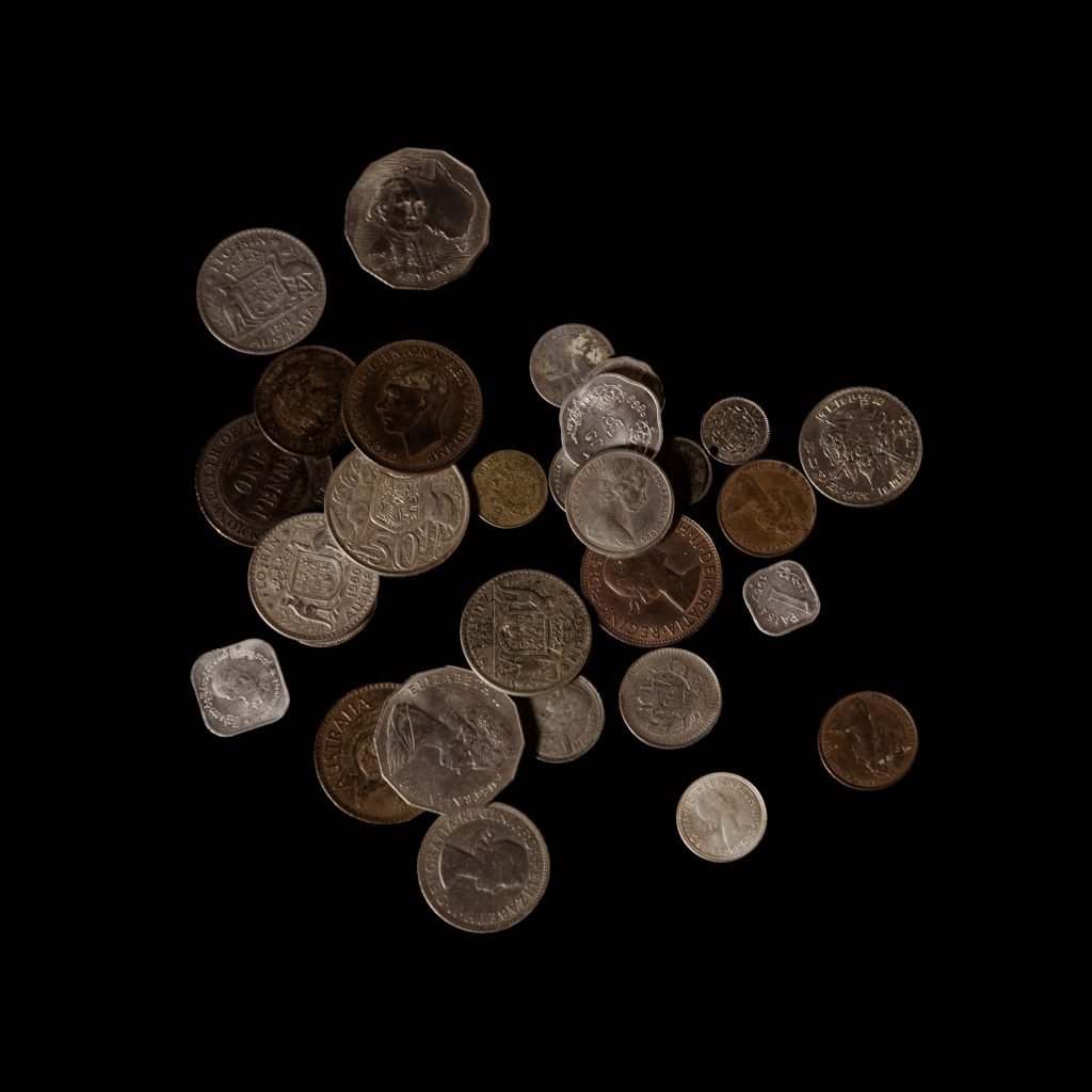 A group of coins from Michael Laycock's, Hannah Laycock's father's, travels in Asia, as part of 'The Fundamental Makings of A Solitary Voyager' archive