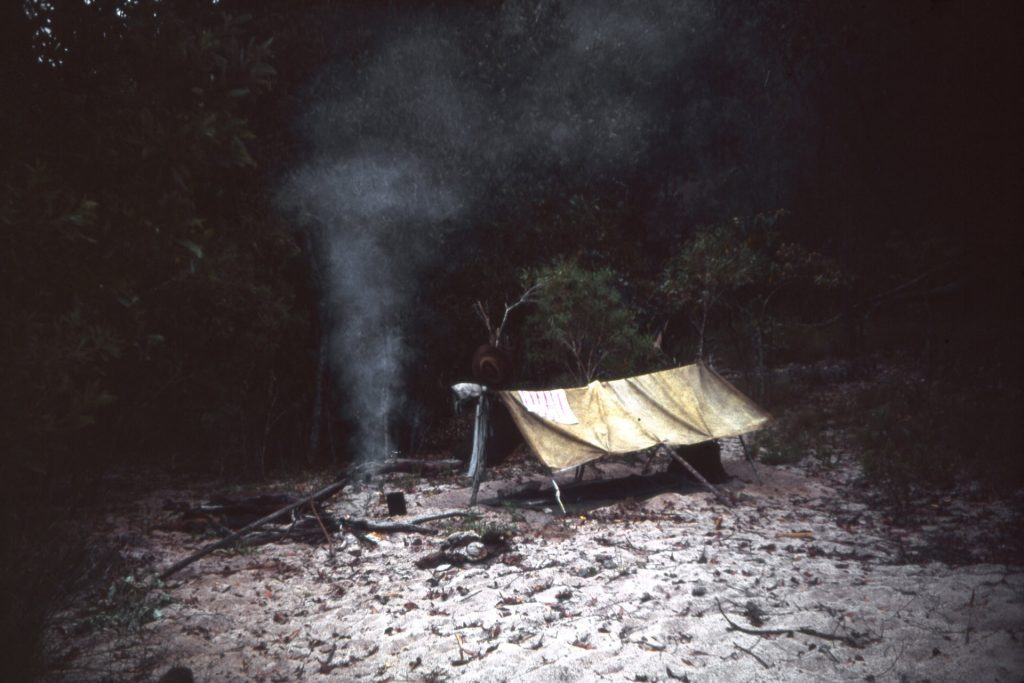 Michael Laycock's, Hannah Laycock's father's, homemade Australian Outback camp next to a fire , as part of 'The Fundamental Makings of A Solitary Voyager' archive